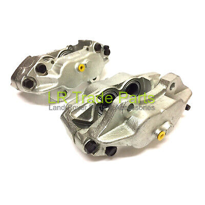 LAND ROVER DEFENDER NEW FRONT BRAKE CALIPERS X2 SOLID DISCS SEB500440/450 300TDi • 87.95£